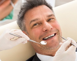 An older gentleman receiving dental care by a holistic dentist