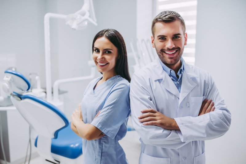 a holistic dentist in Weyauwega and a dental assistant smiling